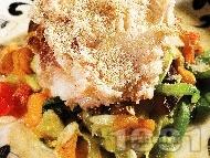 Пържено филе от пъстърва в брашно със задушени зеленчуци - тиквички, моркови, чушки и патладжани на тиган